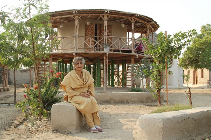 Yasmeen-Lari-outside-a-women's-centre-on-stilts-to-survive-floods-in-Sindh