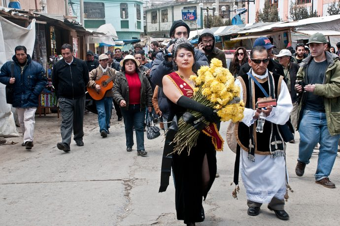 La Ultima Reina leads the procession in her performance piece, 'Romeria Por la Ex-laguna Quilacocha', accompanied by the local priest. Photo by Eduardo Valdez.