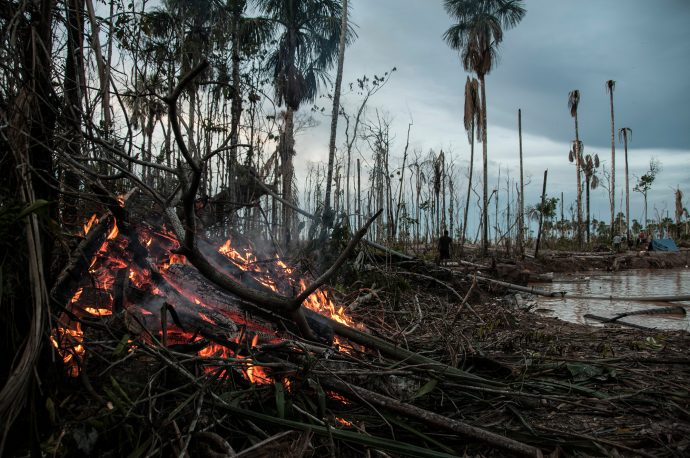 A fire burns on the site of a mining operation in the Madre de Dios region. The clear cutting of forests to expose the mineral rich soils means there is a constant source of fuel for fires. Photo by Maxim Holland.